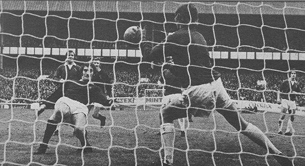 20th October 1973. Everton goalkeeper David Lawson saves close range from Burnley captain Martin Dobson, at Goodison Park.