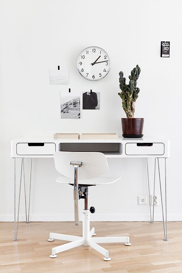 Compact, white home office—and an analog clock!