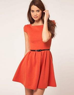 This bright orange dress from Asos is the perfect pop for spring and a great simple palette for statement necklaces!