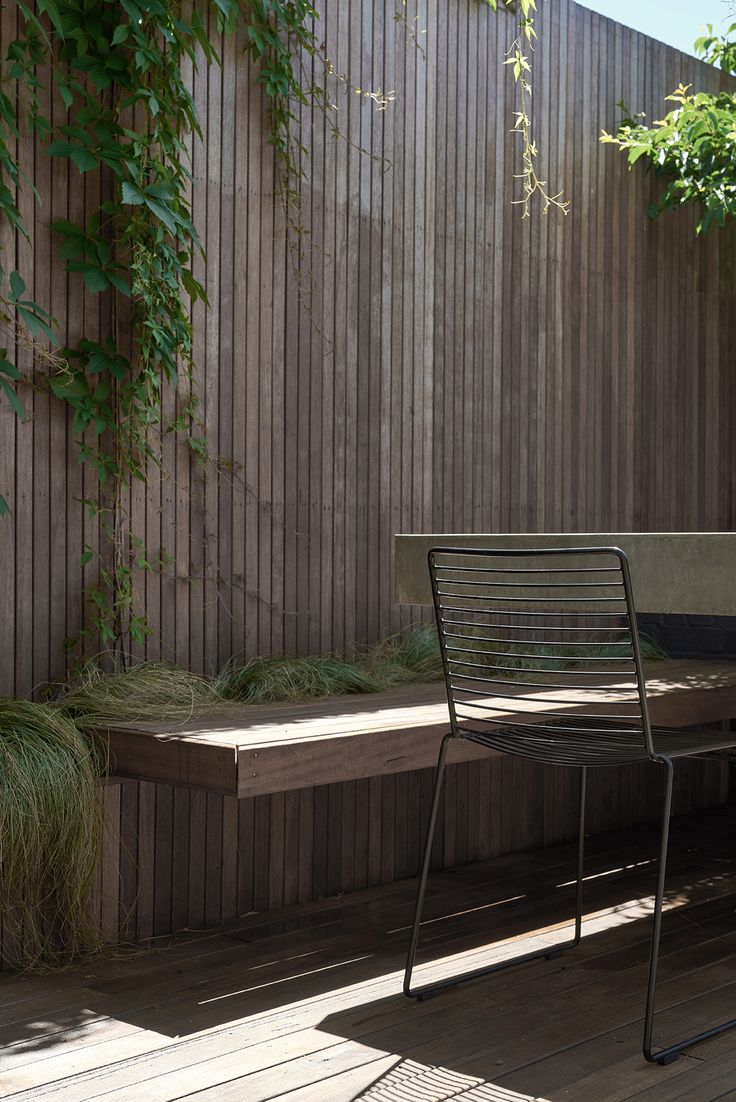 Designed by Acre - Bowen Street. www.acre.com.au Floating timber bench with polished concrete table. Landscaping by Signature Landscapes. Concrete by Hungry Wolf Studio. Chairs by Hay