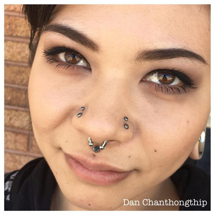 Healed Philtrum with a Black Opal Can from Anatometal for @leahholly! She is not impressed with my hi-jinx as I try to make her smile for pictures. Booking appointments for Wednesday and Thursday before the Baltimore Tattoo Convention this weekend....