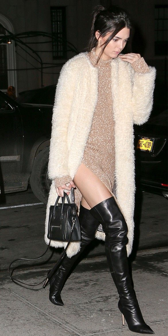 Kendall Jenner rocking a sweater dress, fuzzy long coat, and thigh-high black leather boots
