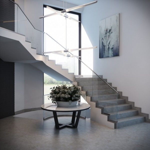 This sweeping staircase with a modern glass rail is simple but edgy//