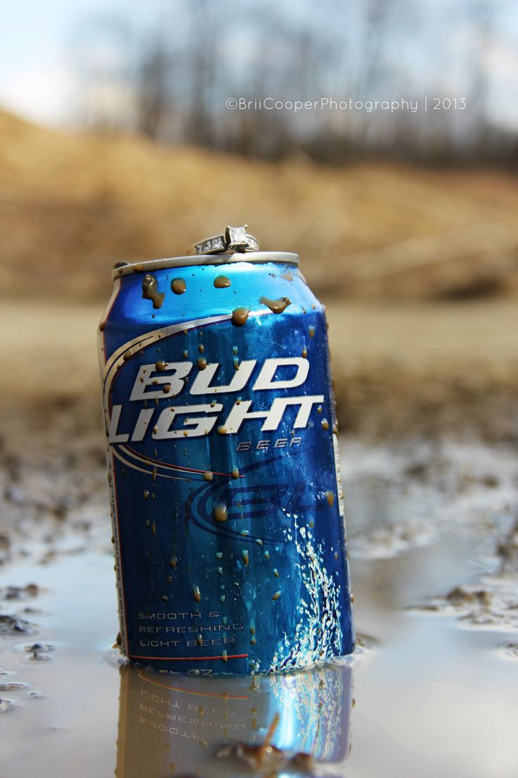 Engagement ring, Beer, and mud gotta love it! If only that were a KEYSTONE can!!