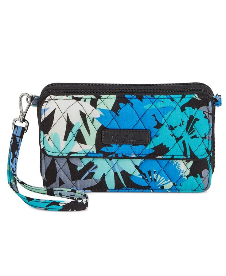 Turned out in a snazzy pop print, Vera Bradley's All-in-One crossbody comes with the added convenience of a cellphone pocket and removable wristlet strap. | Cotton | Imported | Removable wrist strap w