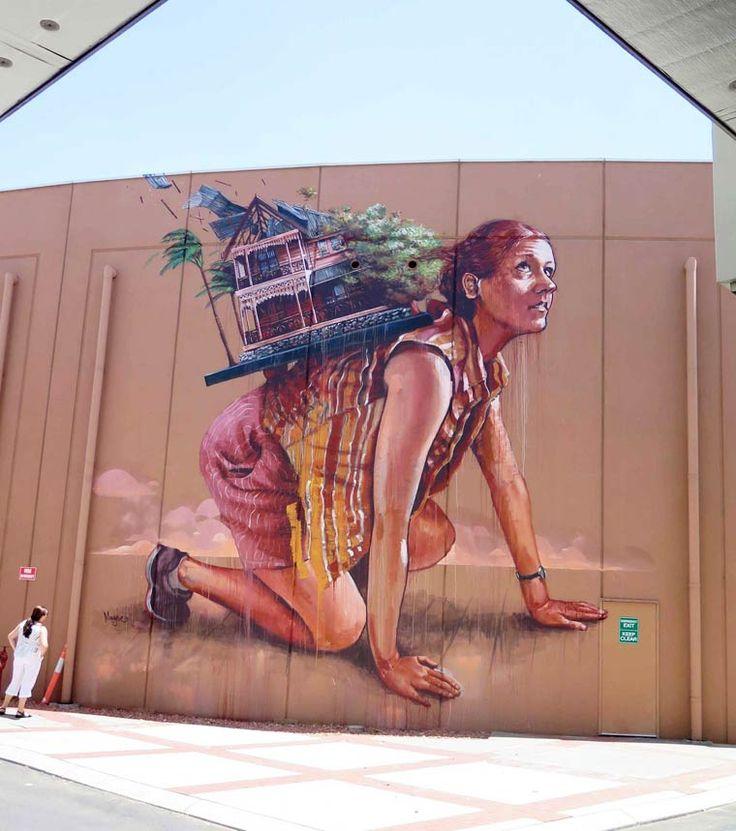 Quand la femme porte à elle seule toute la maison... / Street art. / By Fintan Magee, 2015.