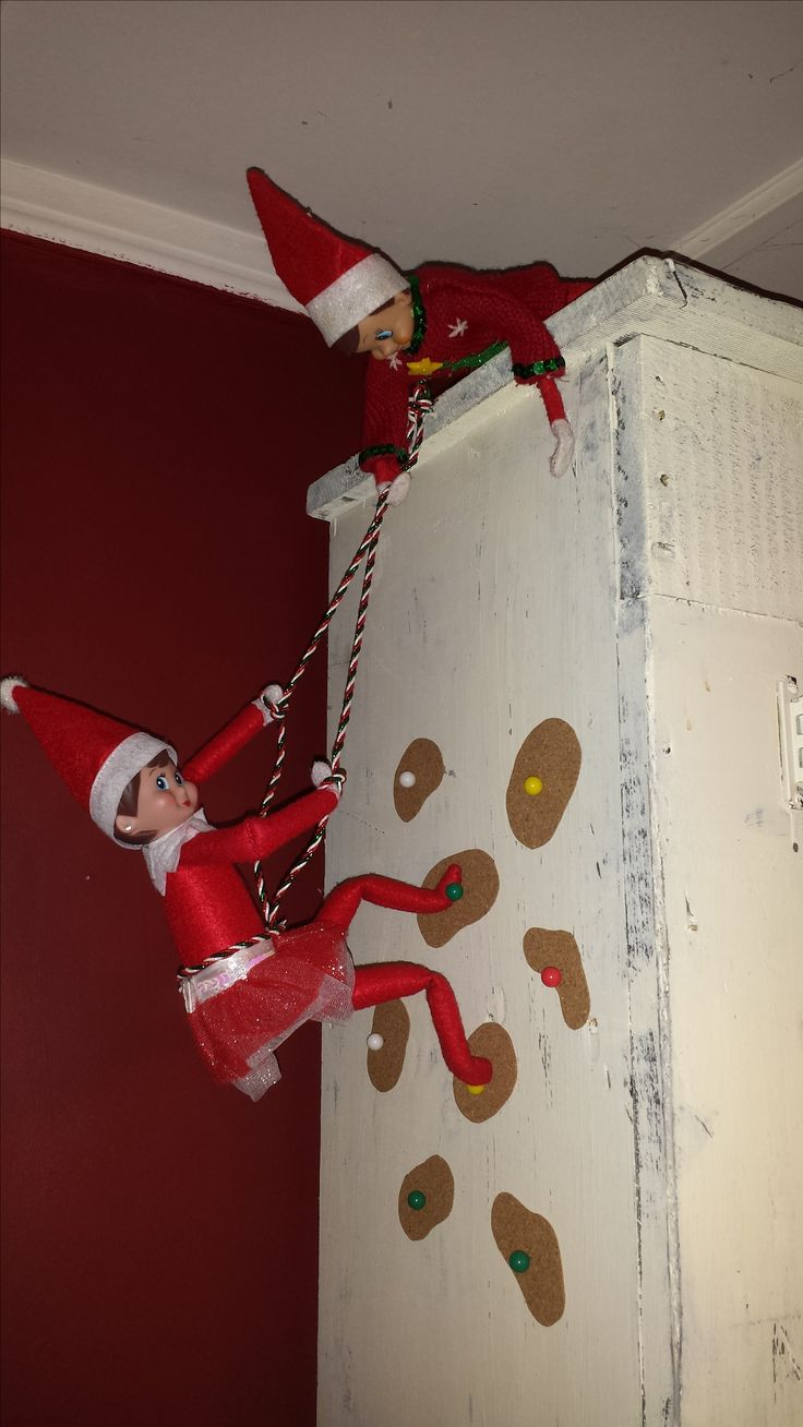 Elf on the Shelf climbing the Rock Wall..This is so cute!!