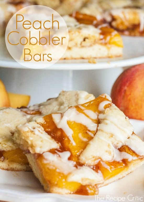 Peach Cobbler Bars at http://therecipecritic.com  Amazing peach cobbler in bars!  Super delicious and makes enough to feed a crowd!