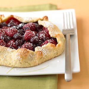 The fruit selection is yours for this dazzling dessert recipe. For juicier fruits such as berries, fold up pastry around the edges to hold in the sweetness.