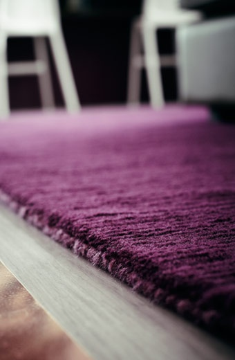 Close-up of purple ALMSTED wool rug