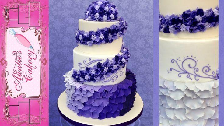 Purple Petal Wedding Cake  Stunning hombre cake with violet flower cascade.