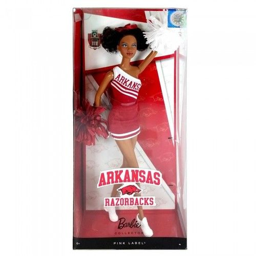 A cheerleader doll that encourages pep and spirit, this African-American University of Arkansas Barbie Doll wears the University of Arkansas colors of cardinal red and white on her authentic uniform and comes with matching pom poms. She is perfect for a Barbie fan who is also a University of Arkansas Razorbacks fan. This Barbie doll is also great for University of Arkansas alumni to give to their daughter or granddaughter to instill an early appreciation for their alma mater.