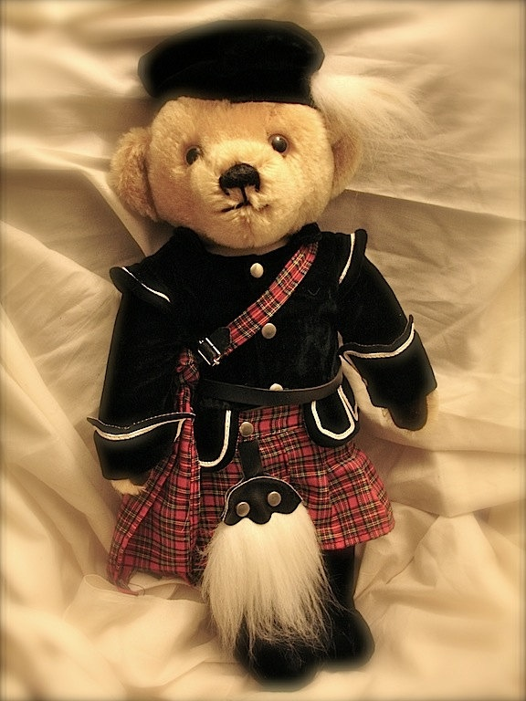 Vintage Harrods English Teddy bear wearing a kilt via Etsy.