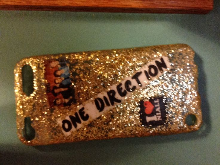 DIY one direction ipod case   First u want a clear case glitter modpoge and scissors   You can print out the 1D logo and pics and put modpoge on them and put them onto the clear case then apply another layer of modpoge over the in hole case. Then take your glitter (I used gold) and dump it into a cup of modpoge and apply the glitter modpoge to the case do a couple more layers of this and u can dry it with a hair dryer if you like and then you are done!! I hope you like it !!