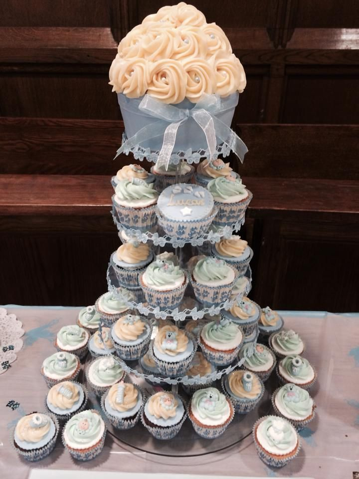 Cupcakes tower topped with a giant cupcake for baby christening