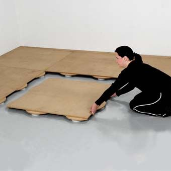 Sprung dance floor system designed as a 3.5x3.5 foot pre-built panelized 2 inch thick sub floor, sprung floor for dance studios and theatres.