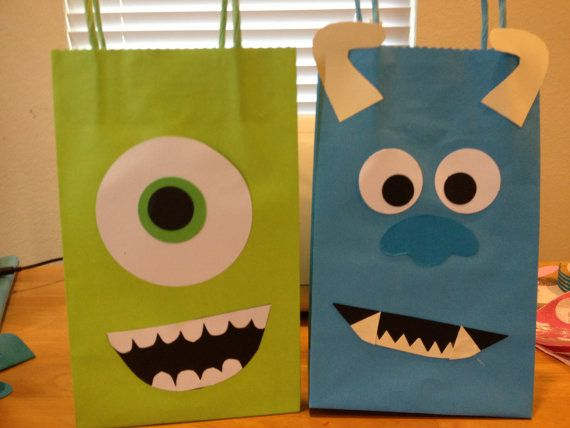 Hey, I found this really awesome Etsy listing at http://www.etsy.com/listing/156199890/monsters-university-party-favor-bags Cute, but these would be easy to duplicate.