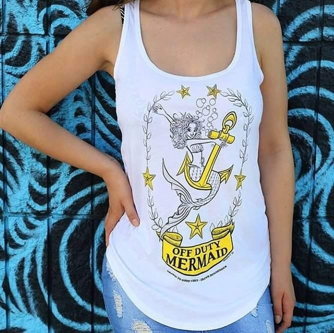 """Off Duty Mermaid "" singlets and tee shirts for Surfer Girls and beach babes. Quality threads, pre-shrunk with cool internal printed tag for comfort and style.  Drawn to good vibes.  Drawn Downunder.  Visit www.drawndownunder.com"