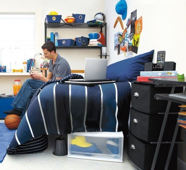 Dorm Decorating For Guys Navy bedding works well for
