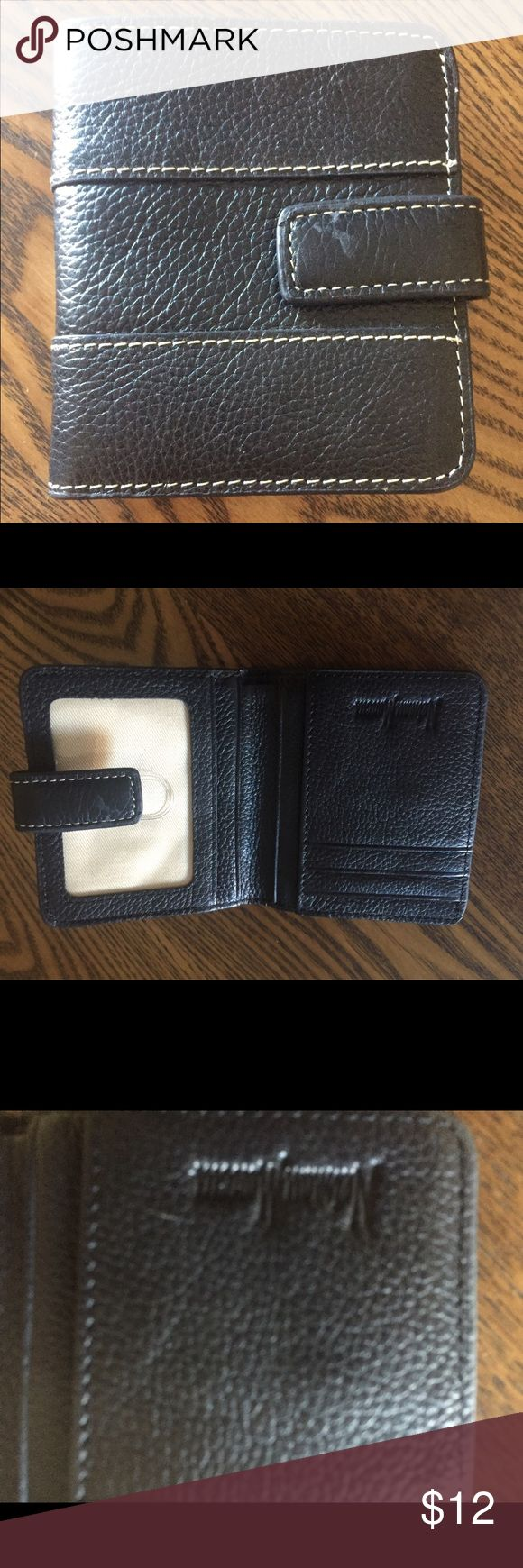 Black Leather Wallet Neiman Marcus NWOT never used. Black Leather Wallet from Neiman Marcus. Black pebble leather with slight cream stitching. Outside back has a zipper compartment for change. Inside plastic slot for ID. 6 slots for credit cards. Longer section too for bills. Snap closer . A compact wallet great for travel or if you like it need a smaller wallet. Dimensions are 3.5 x 4 inches. Neiman Marcus Bags Wallets
