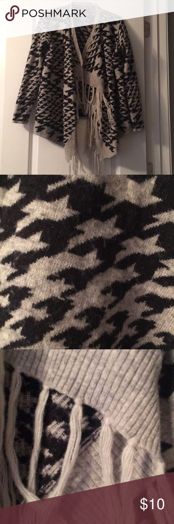 Gray and Black Shrug Sweater Olivia M. cozy patterned gray and black shrug sweater has some wear. 50% nylon, 40% acrylic, 5% angora, 5% lurex. Olivia M Sweaters Shrugs & Ponchos