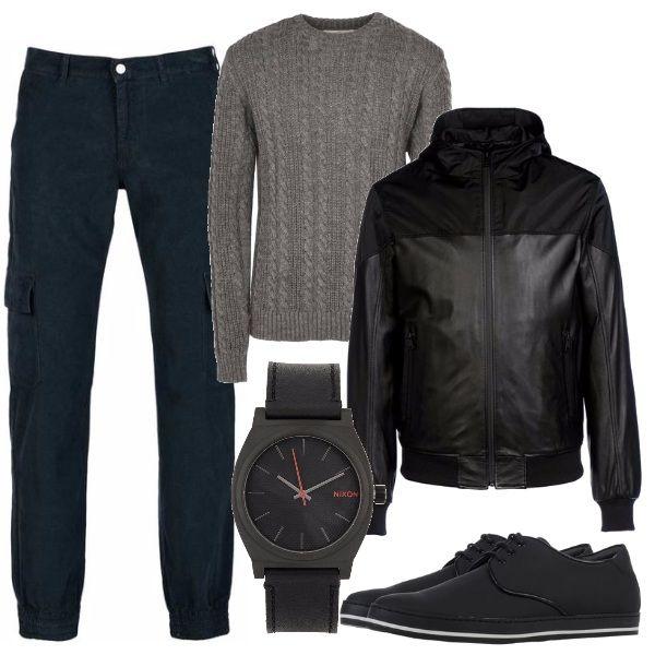 Outfit comodo e versatile pantaloni con tasconi laterali, maglione a trecce, bomber di pelle, sneakers basse profilate e orologio con particolari rossi.