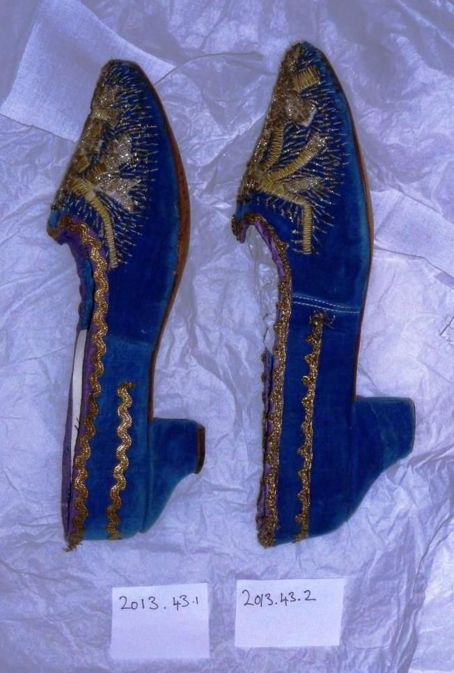 Pair of ladies shoes in blue velvet with metallic thread embroidery. Possibly decorated / altered at a later date. Heel altered. c.1810-20