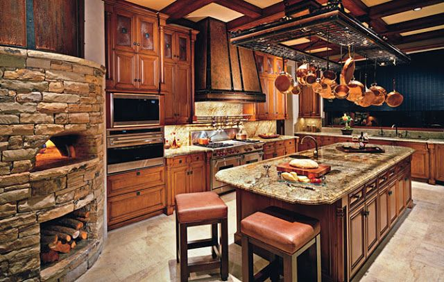 #PizzaOven!!! Lots of rich warm woods used here, love the pizza oven and storage for wood underneath, you could have some fun pizza parties in this #kitchen!  #Enchanting    ::)