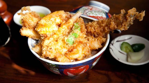 Dote no Iseya in Minowa - First founded in 1889, this retro restaurant serves tempura over rice in three types, all with different toppings: the choices are I (¥1,400), Ro (¥1,900), and Ha (¥2,300). On your first visit, we recommend the Ro or Ha, which include eel and toppings like two jumbo prawns, vegetables and kakiage, cooked with a mixture of sardines, prawns and shellfish. The batter is crispy but fluffy and the sauce offers a good balance of sweet and salty. Long queues are to be…