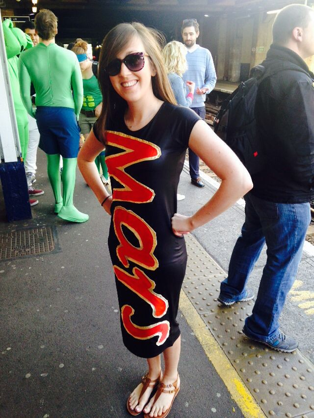 Mars bar chocolate bar costume! Made the outfit for space themed fancy dress but also wore at Halloween! Just bought a wet look black dress and some red and gold fabric; made some paper letter stencils and used them to cut out the fabric letters; and then sewed them on!