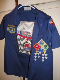 book hanger for the cub scout shirt... this way there's a place for the book to be put and kept with the shirt.