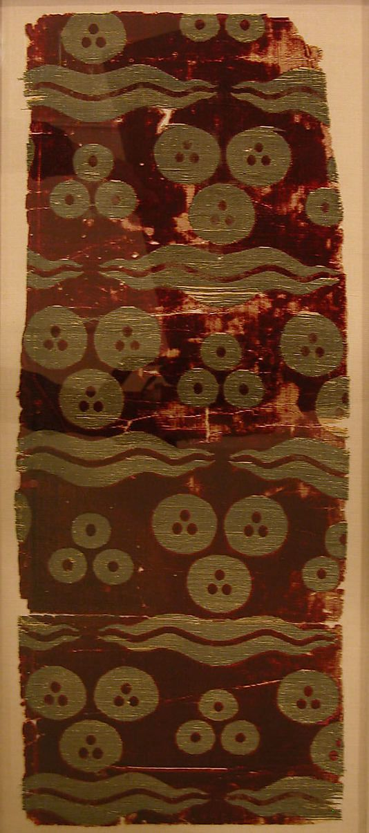 Silk Velvet Fragment with Tiger-stripe and 'Cintamani' Design Object Name: Fragment Date: 16th century Geography: Turkey Culture: Islamic Medium: Silk, metal wrapped thread; cut and voided velvet, brocaded