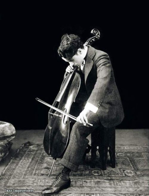 """Life is a tragedy when seen in close-up, but a comedy in long-shot.""  Charlie Chaplin playing the cello, photographed in 1915. Sir Charles Spencer ""Charlie"" Chaplin (16 April 1889 - 25 December 1977) played both cello and violin left-handed, and he had both his violin and cello restrung and rebuilt."