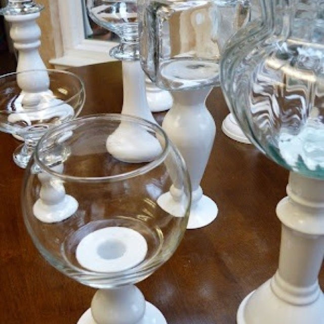 Candy jars.  dollar store vases, candle holders, bowls... etc...  spraypaint the items you want to be the base, and glue the clear glass bowl to the top for a festive candy bar.  :)