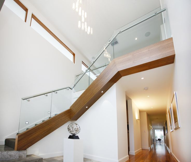 This dramatic staircase makes an impressive entry statement but still allows the home to enjoy an open feel with glass, highlight windows and high ceilings.