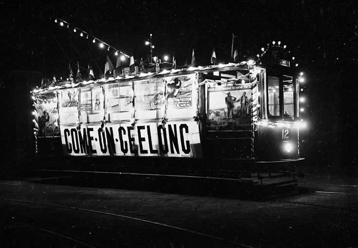 A tram used for recruiting during World War I. There are posters along the side of the tram and the sign 'Come on Geelong'. The posters on the tram include 'Line Up Boys, Enlist Today' (Australian War Memorial collection ART00426), 'We're Both Needed to Serve the Guns!' (Australian National University collection 1885/7193) and 'Boys Come Along, You're Wanted' (Australian War Memorial collection ...