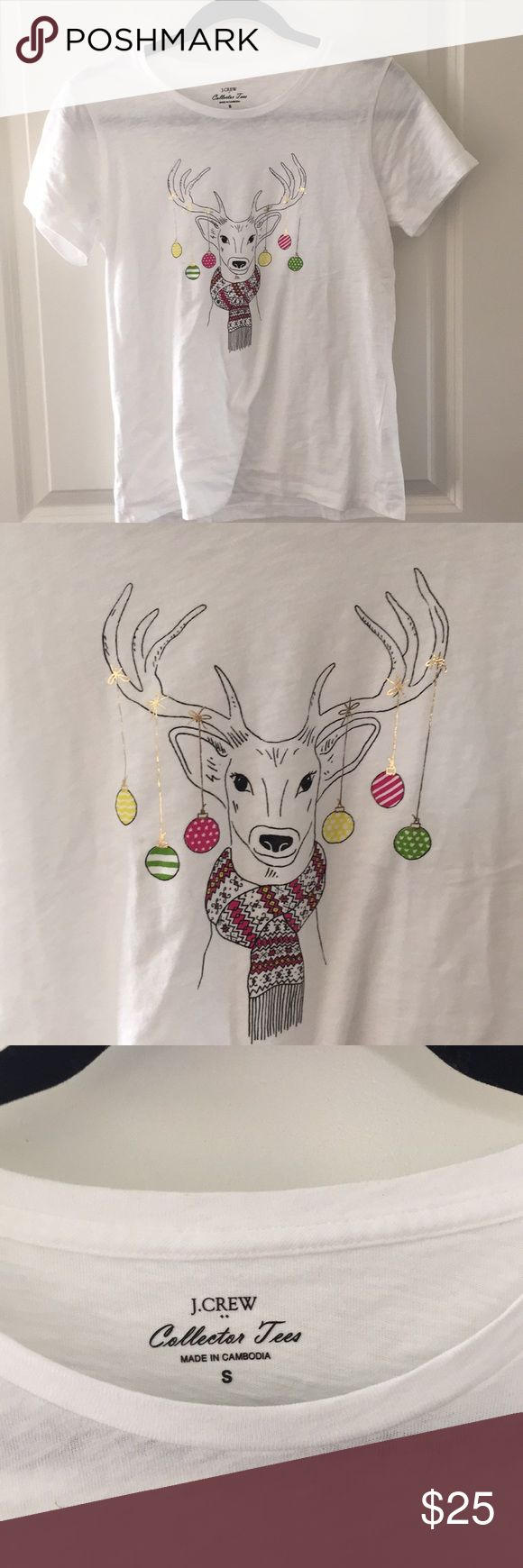 NWOT J.Crew Reindeer and ornaments t-shirt, S NWOT J.Crew white tee shirt with an adorable Reindeer in a scarf with ornaments hanging from his antlers on shiny gold strings. From the J.Crew Collection Tees department. Size small. 100% cotton. Love this shirt but I meant to buy a XS and only realized it was a small after I put it on. Never wore it aside from putting it on for 10 seconds. Super fun for the holidays! J. Crew Tops Tees - Short Sleeve
