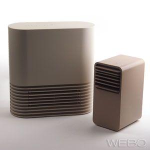 PlusMinusZero Mini Ceramic Fan Heater - Image compares size to a competitors small model.