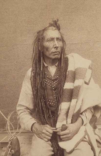 Cree chief Poundmaker, who was involved in the North West Rebellion, in leg irons, Regina, Saskatchewan, 1885 / Le chef cri Poundmaker, fers aux pieds, qui a participé à la Rébellion du Nord-Ouest, Regina, Saskatchewan, 1885 | by BiblioArchives / LibraryArchives