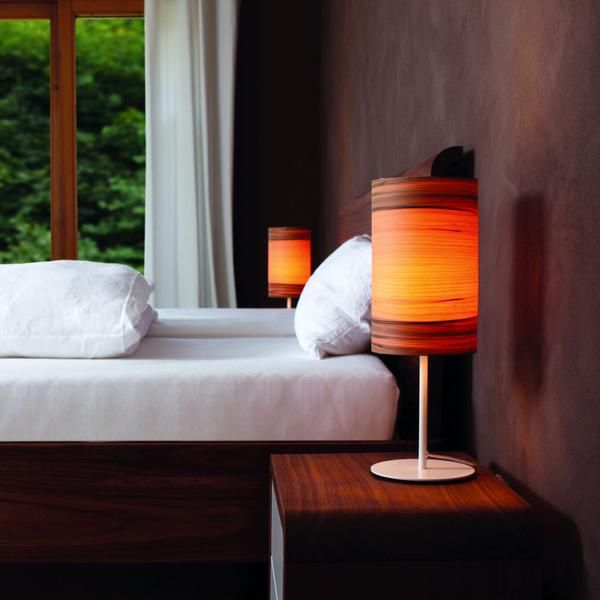 The Funk table lamp by dreizehngrad features an elegant maple or walnut veneer shade atop a slim white base. Ideal for a bedroom or living room, the minimalist piece...