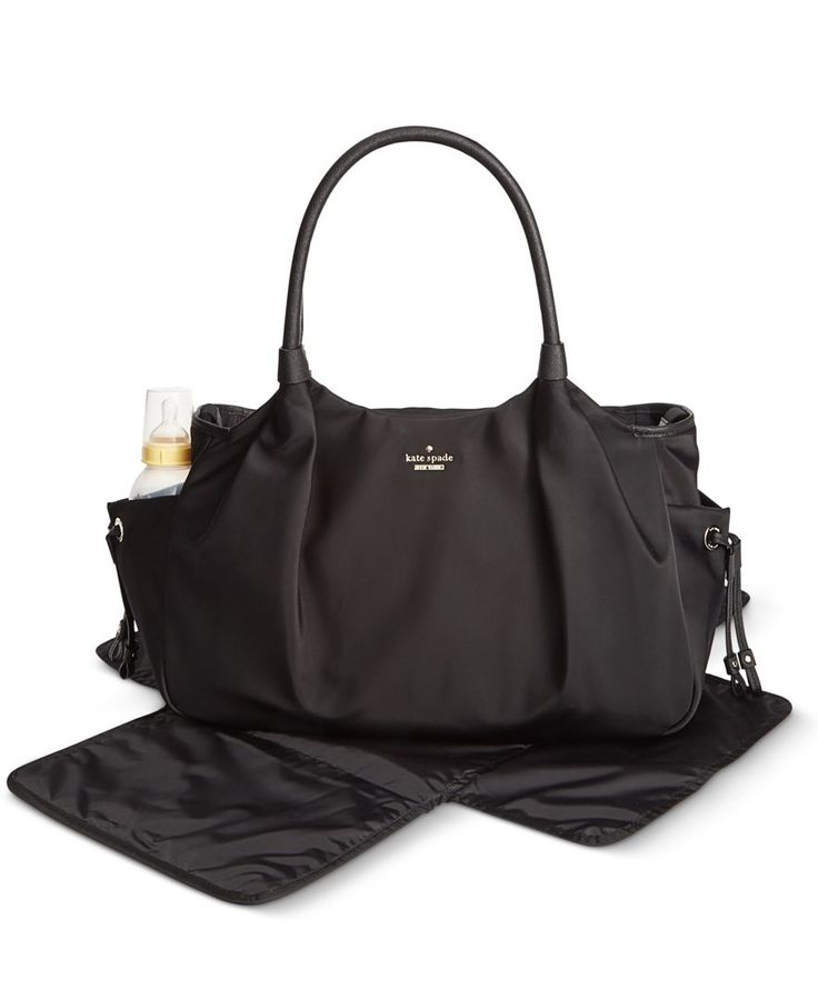 An adorable gift for mom and baby, this lightweight, yet roomy diaper bag has all the necessary pockets and straps while retaining the chic style typical of kate spade new york. Includes changing mat.