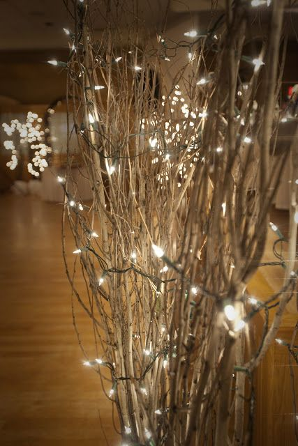 Branches wrapped in white lights are perfect for winter weddings