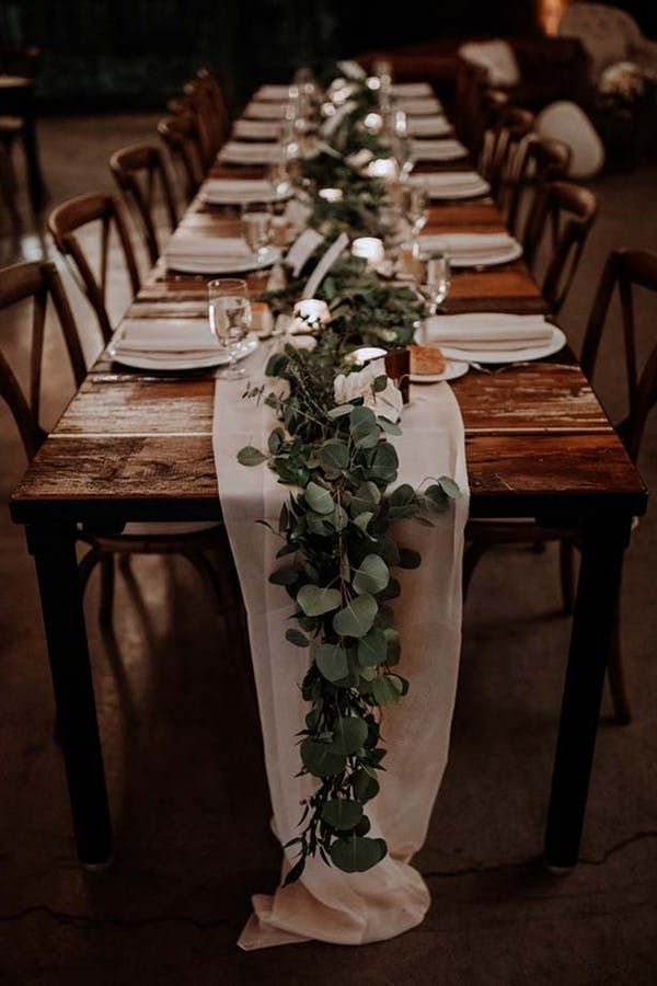 GREENERY RUNNERS. 20 Stunning Tablescape Ideas for a Boho Wedding #purewow #flowers #decor #wedding #weddingdecor #weddinginspiration #weddingtablescapes #bohoweddings #bohobrides #weddingdecorations #weddingtables #weddinggreenery