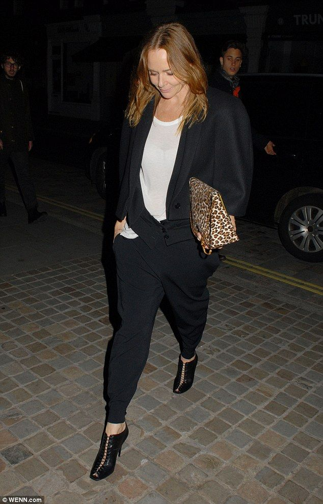 Seriously stylish: Designer Stella McCartney wore hareem trousers and peep tor boots on th...