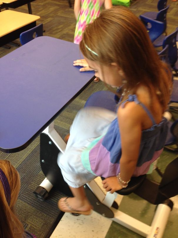 My Daughter's First Grade Classroom Has Desks With Pedals So Kids Can Move While Learning