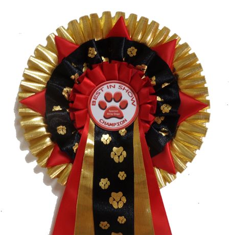 Marbella Aztec Gold Star Rosette. Super for all pawed animal shows and for pawed animal lovers! Other print is available for horses and even human feet!  Printed with human feet are excellent rosettes for christenings (and the like) and birthday gifts. Contact us if you have something in mind. We love to make unique rosettes for our clients! http://escarapelas.com/