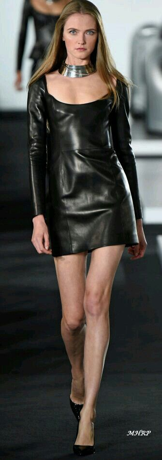 Black leather minidress with silver collar necklace runway fashion