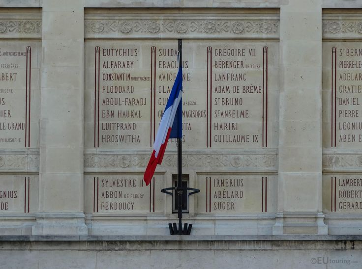 The names of many French scholars that are inscribed on La Bibliotheque Sainte-Genevieve, with an additional French flag in view.  More at; www.eutouring.com/images_paris_city_life.html
