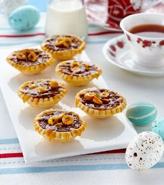Dark Chocolate and Salted Caramel Tartlets - Delectable Easter tarts with chocolate, toffee and nuts. Perfect to share during your Easter family holidays.