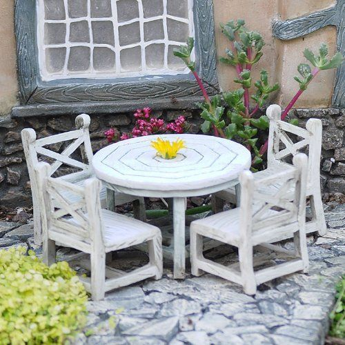"Tea-Time Table and 4 Chairs . $34.99. material: Resin & Granite. size: Table 2.75"" dia x 2.5"" high, Chair 2x2x3"". scale: 1:12. A formal garden begs for civilized entertaining, i.e., tea at half past three. The fairies in your garden will love taking tea and crumpets at this little outdoor table and chair set. What imaginings could occur beneath the shade of a miniature blooming tree!"